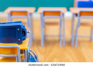 School bags and desks and chairs (image of admission)