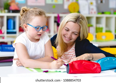 At school - beautiful teacher helps her student to learn