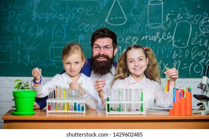 School biology experiment. Explaining biology to children. How to interest children study. Fascinating biology lesson. Man bearded teacher work with microscope and test tubes in biology classroom.