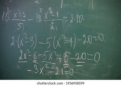 school blackboard with a mathematical equation