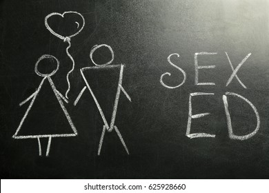 School blackboard with text SEX ED