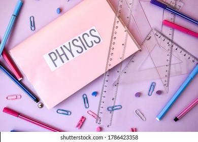 school book. physics with supplies stationery on color background, back to school, ruler, pencils