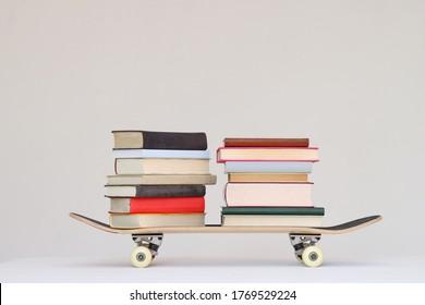 School books on a skateboard