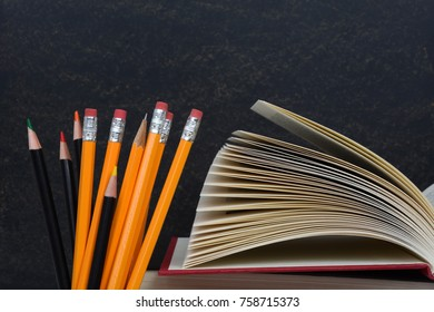 school books pencils and chalkboard educational concept