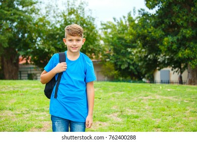 School Boy with backpack at the park
