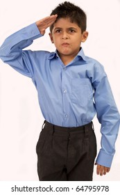 school boy gives salute isolated on white background