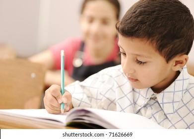 school boy is writing