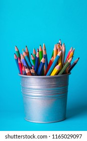 school - bucket with colorful pencils on a blue background