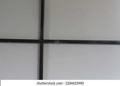 The school building walls are covered with smartboards.