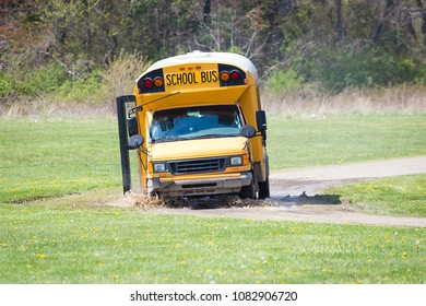 School bus driving in mud stuck on the road