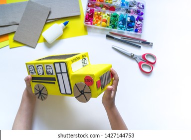 School bus made of cardboard. DIY children's pencil case for stationery paper craft. Back to school. Children's garden. White background