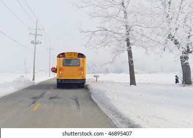 School bus on winter morning in rural area.