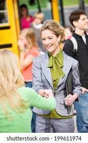 School Bus: Principal Welcomes Student To First Day Of School