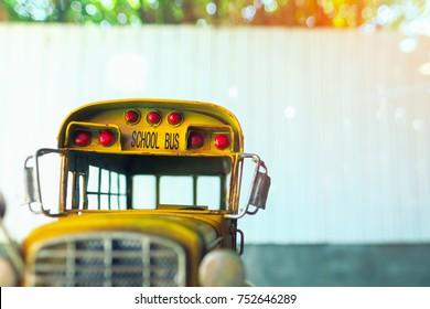 School bus toy model. Vintage color tone.