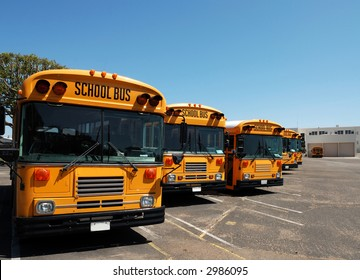 School Buses Lined Up and Parked For The Weekend