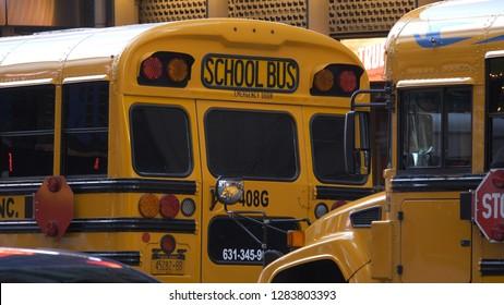 School busses in New York - NEW YORK / USA - DECEMBER 4, 2018