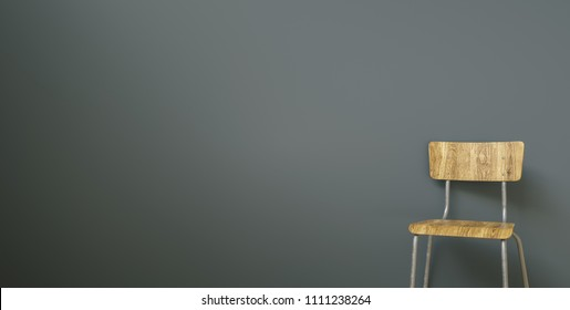 School chair in front of a grey wall, with copy space for individual text