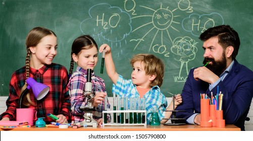 School chemistry experiment. Explaining chemistry to kids. Fascinating chemistry lesson. Man bearded teacher and pupils with test tubes in classroom. School chemistry lab. Science involves theory.