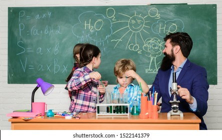 School chemistry experiment. Fascinating chemistry lesson. Man bearded teacher and pupils with test tubes in classroom. Explaining chemistry to kids. Science is always the solution. Observe reaction.
