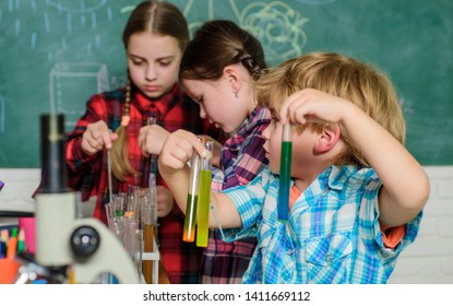 School chemistry laboratory. Laboratory Research - Scientific project For Chemical test. back to school. Science and education. chemistry lab. happy children. Studying with help of microscope.