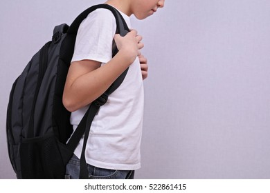 School child with backpack. Incorrect posture concept.