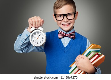 School Child in Glasses with Alarm Clock and Books, Smart Kid Boy Pupil Show Time Back to School, Education Concept