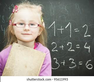 school child near blackboard See my portfolio for more