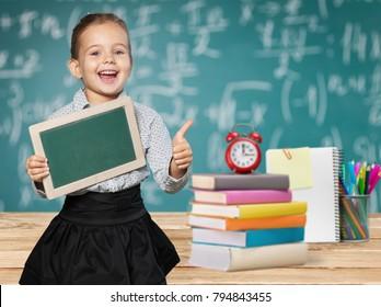 School child and school supplies
