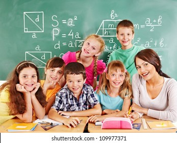 School child with teacher in classroom.