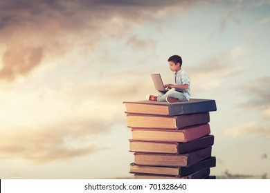 School child using laptop on the books.Study and education concept.