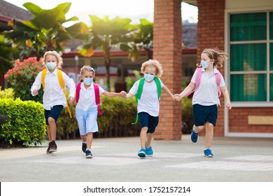 School child wearing face mask during corona virus and flu outbreak. Boy and girl going back to school after covid-19 quarantine and lockdown. Group of kids in masks for coronavirus prevention.  - Shutterstock ID 1752157214