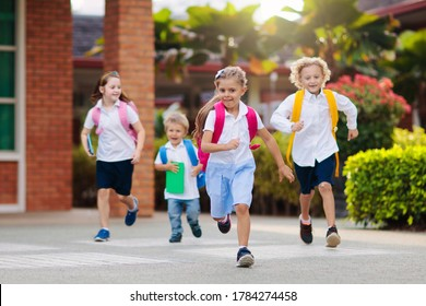 School child wearing face mask during corona virus and flu outbreak. Boy and girl going back to school after covid-19 quarantine and lockdown. Group of kids in masks for coronavirus prevention.  - Shutterstock ID 1784274458