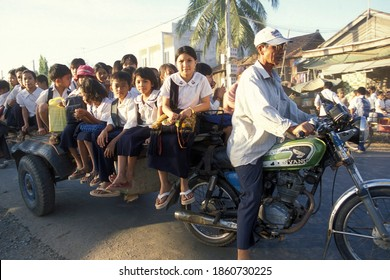 School childern on the way to school in the city of Phnom Penh of Cambodia.  Cambodia, Phnom Penh, February, 2001,