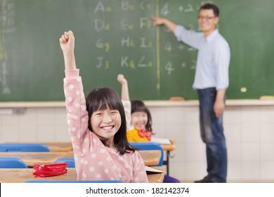 School children in classroom at lesson