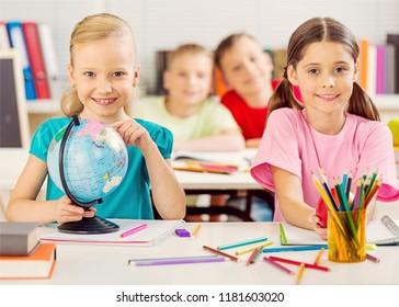 School Children in the Classroom Writing /