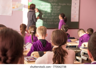 school children are participating actively in class.