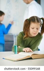 School children and teacher in classroom at elementary school in science class.?