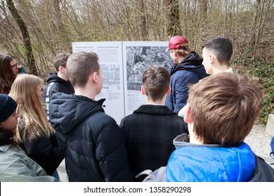 School children and their teacher at former Dachau concentration camp (Konzentrationslager - KZ) memorial site. Dachau, Germany - Mar 26. 2019.
