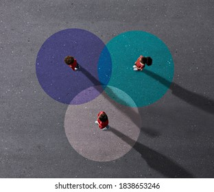 School children in uniforms standing on painted Venn Diagrams. It color is cyan, blue & white.