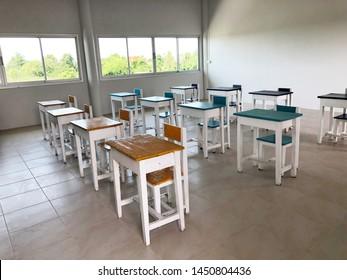School class with school desks, blackboard.