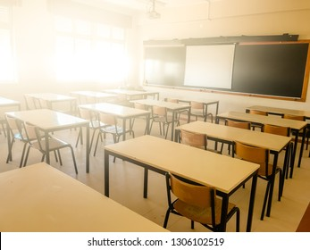 School classroom in blur background without young student; Blurry view of elementary class room no kid or teacher with chairs and tables in campus