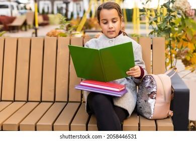 School club. Modern education. Private schooling. Teen with backpack. Stylish smiling schoolgirl. Girl little fashionable schoolgirl carry backpack school building background. Schoolgirl daily life.