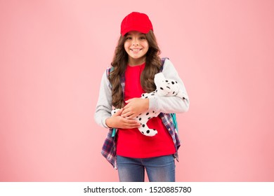 School club. Stylish schoolgirl. Girl little fashionable cutie with backpack carry soft toy dog. Take favorite toy with you. Reduce stress. Schoolgirl daily life. Schoolgirl street style clothes.