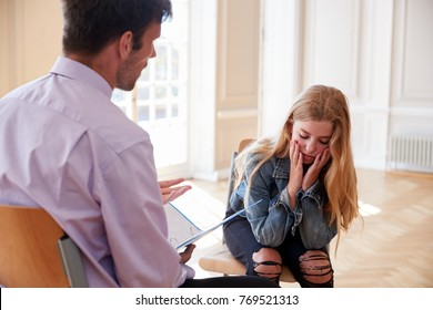 School Counselor Talking To Depressed Female Pupil