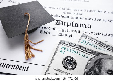 School diploma and mini grad cap with cash