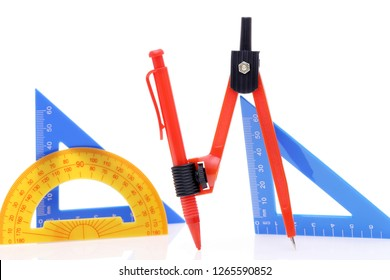 School drawing tools. Compass, triangle, ruler on white background
