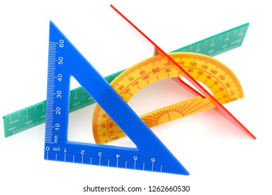 School drawing tools. Triangle, ruler, protractor on white background