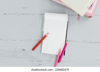 School, education. Blank notepad on the table