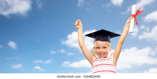 school, education and learning concept - happy little girl in bachelor hat or mortarboard with diploma celebrating success over blue sky and clouds background