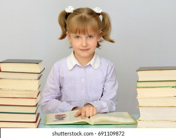 School education and literacy, girl child education and reading books in the library or classroom.